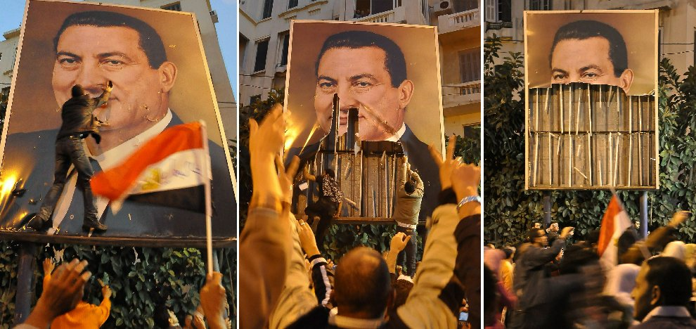Демонтаж плаката с изображением президента Хосни Мубарака