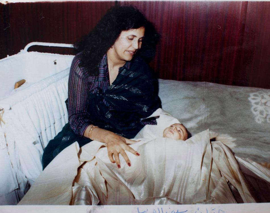 Сын полковника Сейф аль-Ислам и его жена