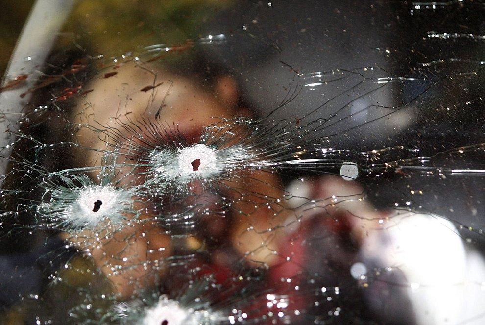 Убитый боевик в машине, штат Мичоакан, Мексика