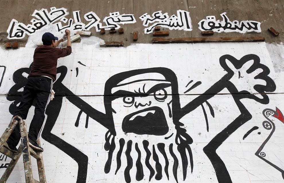 Создание граффити в поддержку про-президентского движения «Братьев-мусульман»