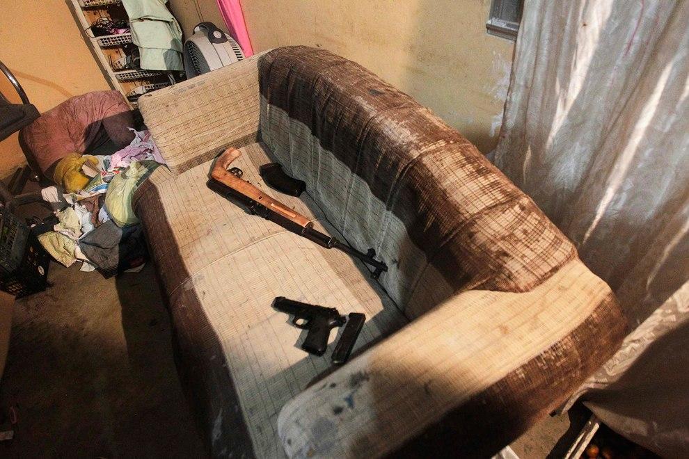 Конфискованное оружие после ареста нескольких членов банды в Сан-Педро-Сула