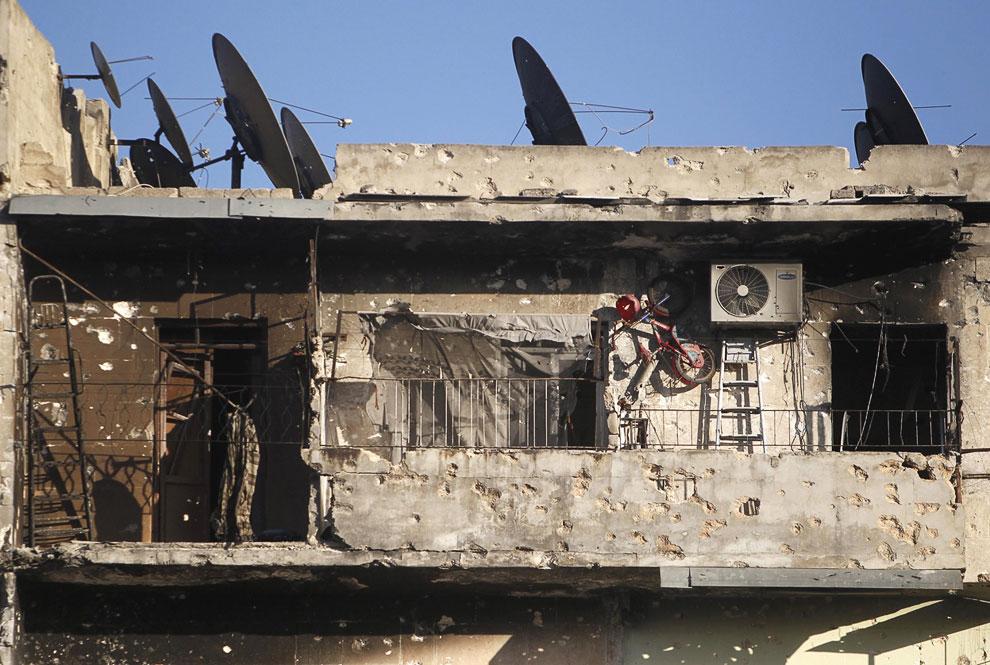 Трудно найти дом в Алеппо, не изрешеченный пулями