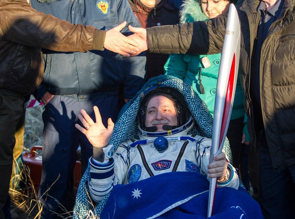 11 ноября Олимпийский факел вернулся на Землю