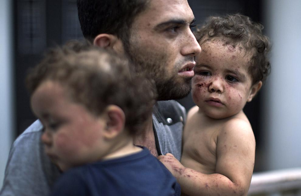 Палестинец с дочерью, город Газа