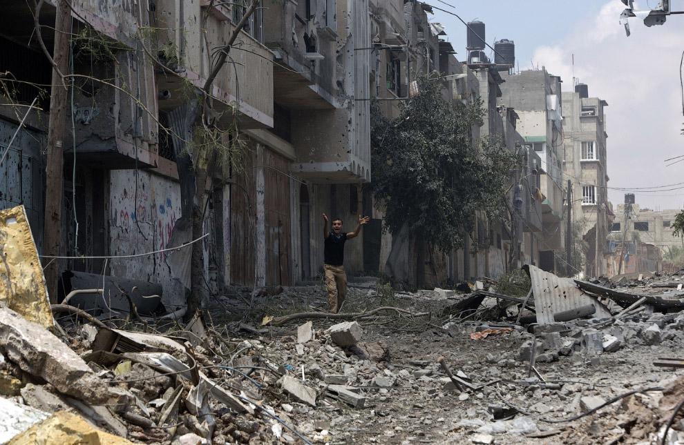 Разрушенный обстрелами район сектора Газа