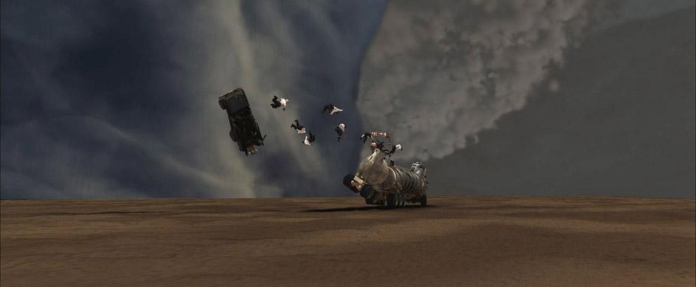 Пылевой торнадо засасывает в себя пламя, машины и людей