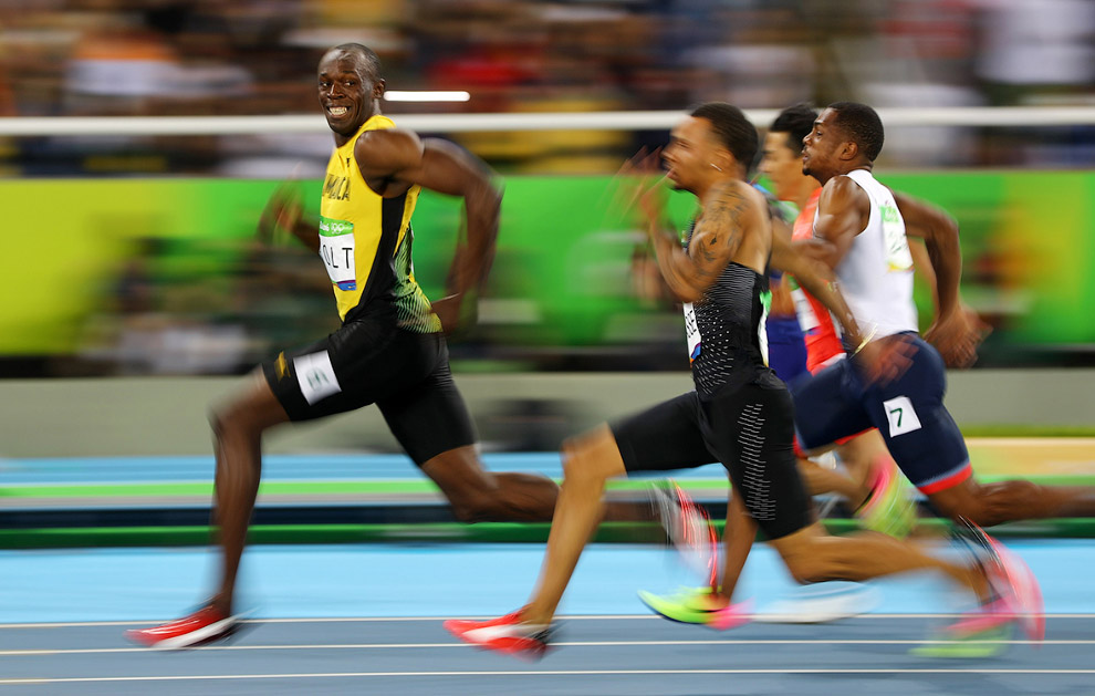Усэйн Болт из Ямайки на 100-метровке Олимприады