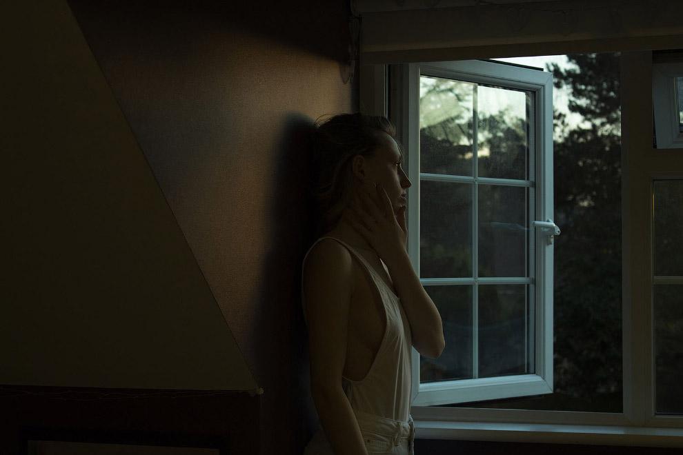 У окна в спальне.