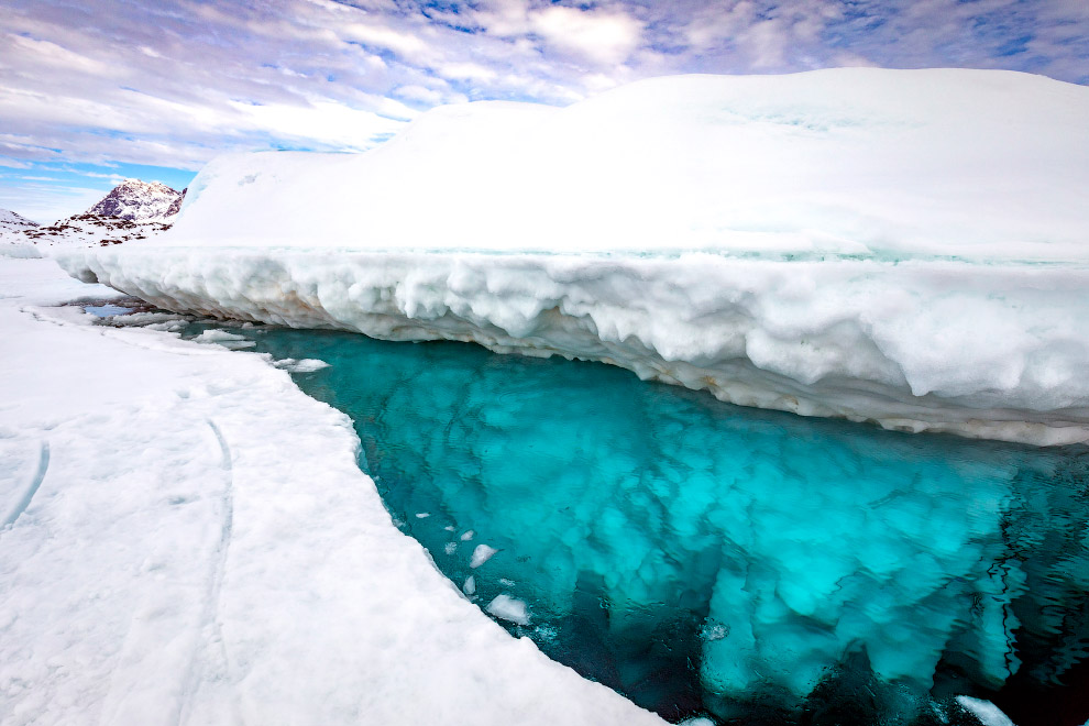 Stunning photos show ice dive beneath giant iceberg