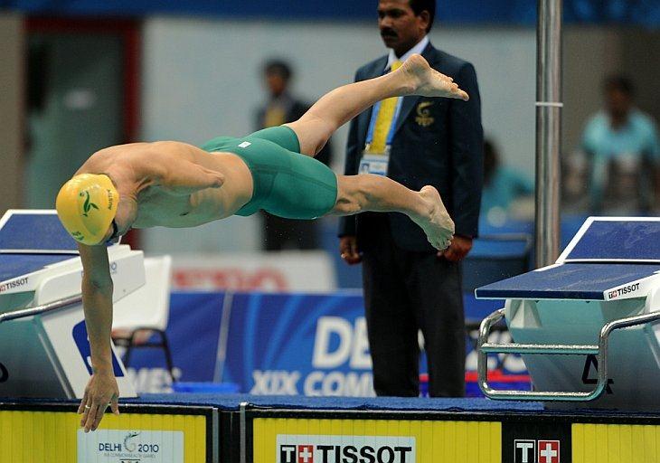 Бенджамин Остин из Австралии в финале мужчских соревнований на 100-метровке вольным стилем на Играх Содружества в центре Мукерджи в Нью-Дели 8 октября 2010 года